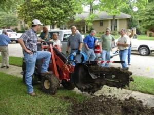 Oakley CA sprinkler repair team with the trencher